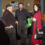 Terry Bisson, Cliff Winnig, and Diana Sherman hanging out in the lounge.
