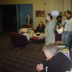 The early crowd watches Eliot play the theremin. Terry Bisson is in the foreground.