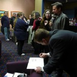 The crowds gather, and get an early start on the signings.