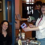 Rina Weisman and Rick Kleffel buy books from Jude Feldman