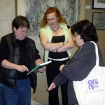 Ellen Klages, Cheryl Morgan and Lisa Goldstein check out one of Cheryl's purchases